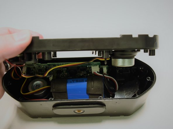 Gently pull apart the front panel from the base of the speaker.