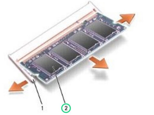 Use your fingertips to carefully spread apart the securing clips on each end of the memory module connector until the memory module pops up.