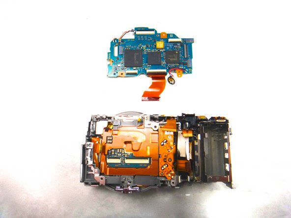 Image 2/3: The removed motherboard and camera body should now appear as shown.