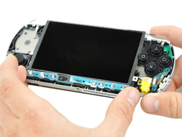 Image 1/2: Do not attempt to remove the home bar yet, it is still attached to the PSP 300xc.