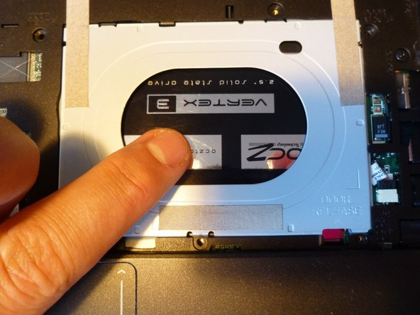 Now push the HDD downwards with the finger through the hole.