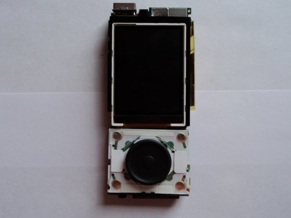 Flip the circuit board over to look at the back side, so that LCD screen is facing away from you.