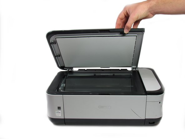 Open the scanner cover, as if you are going to scan a document.