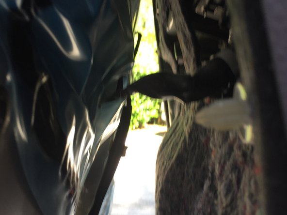 There is one electrical connector for the door light that need to be removed in the panel.  From the bottom of the door, with the panel opened up, I pressed in on the tab in the middle of the harness connector will release the harness and simultaneously then we need to pull the harness down, away and out of the mating connector