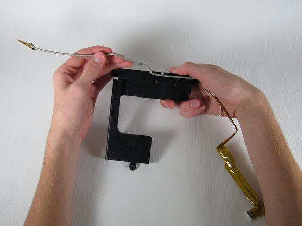 Lift the speaker unit up, flip it, and remove the USB cable.