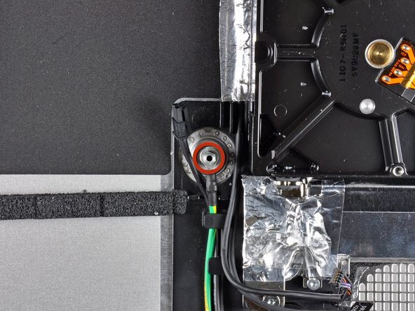 Image 1/2: De-route the AC-in and ground cables from the clips in the outer case.