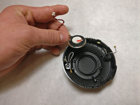Remove the speaker by gently pulling on the wire near the speaker.