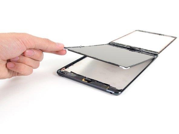 Lift the LCD up a couple inches from the rear case to ensure it's free from the adhesive.