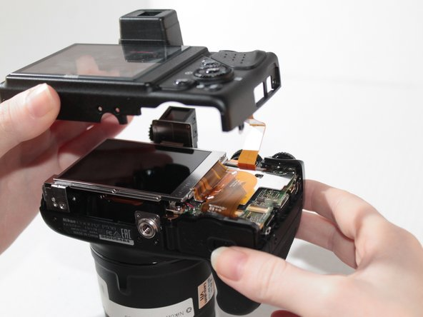 After the ribbon cable is removed from  the camera body, the cover can be completely removed.
