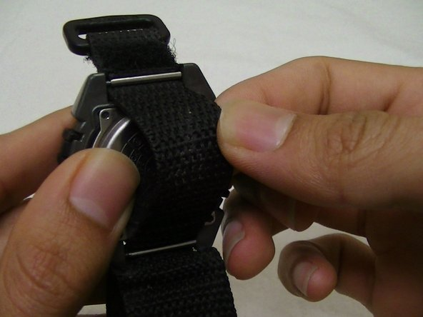 Image 1/2: Gently pull away the metal covering away from the watch.