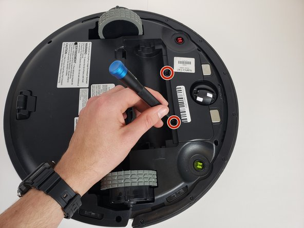 Using a Phillips #0 screwdriver, remove the two 12.25 mm  screws holding the battery cover in place.
