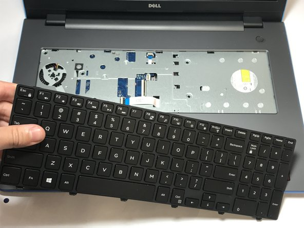Now that the keyboard is detached from the laptop, you may safely remove it.