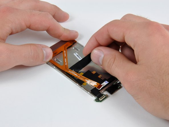 Image 1/2: Remove the display ribbon from the back of the LCD.