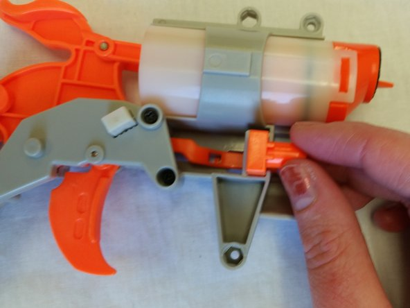 Slide the orange supporting piece into the crevice below the air chamber.