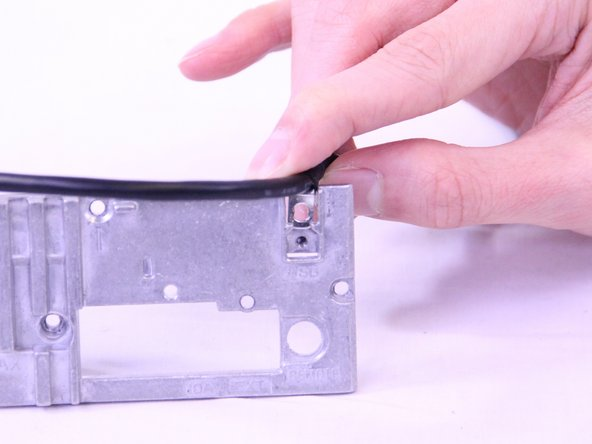 Pull the USB cable off of the back plate.