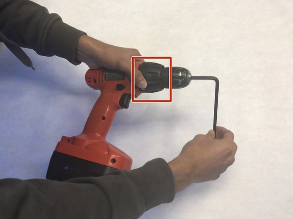 Set the drill to 'drill mode' and tighten the chuck with the Allen wrench in it.