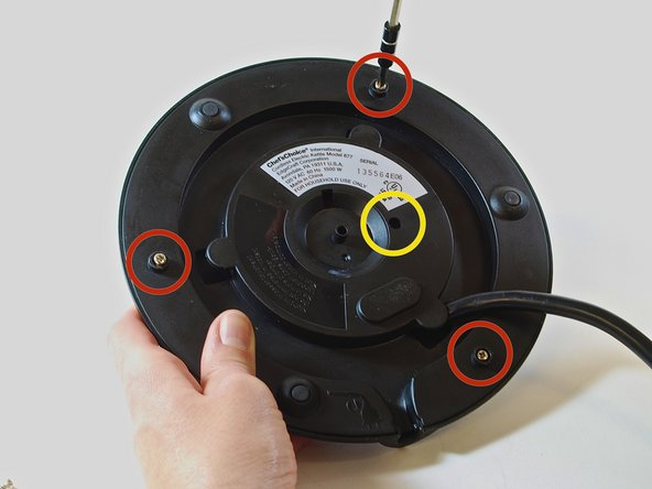 "Using a #1 TRIANGULAR head screwdriver, tighten the 3/8"" TRIANGULAR Phillips screw at the center of the base plate"