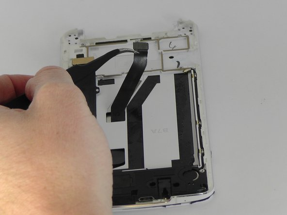 Use tweezers to peel the black strip from the sticky tape attached to the phone so that the black strip will slide through the phone once the screen is removed.