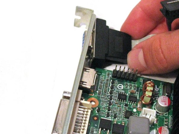 Remove the other end of the ribbon cable from the bracket.