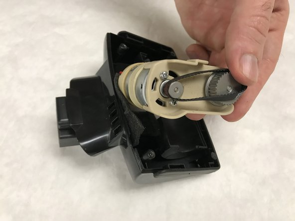 Place the motor assembly back into the motorized brush enclosure.