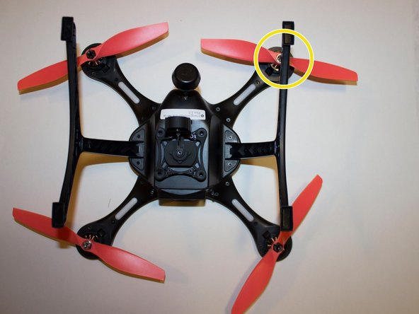 Turn the drone on its back and identify the propeller that needs replacing.