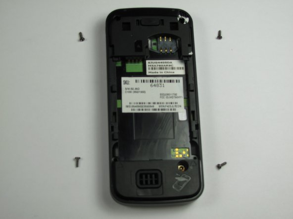 Using a Torx T-4 screwdriver, carefully remove the 4 screws located at the corners of the phone.