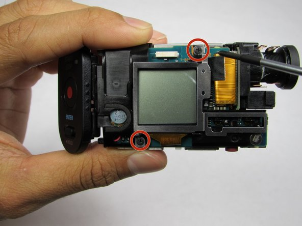 Remove the two 1/4 in. Phillips screws on the LCD side of the device using a #00 Phillips head screwdriver.