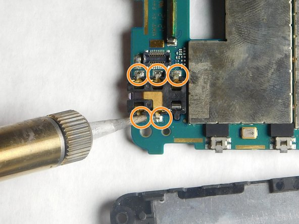 Image 2/2: There are 5 soldering locations from the top view and 5 locations from the bottom view