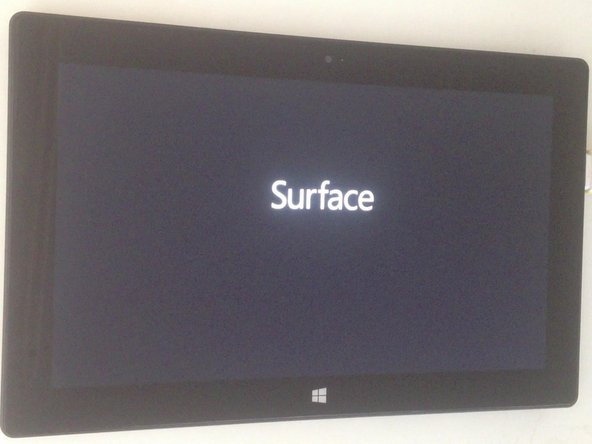 Image 3/3: - When the Surface logo appears, release the Volume button.