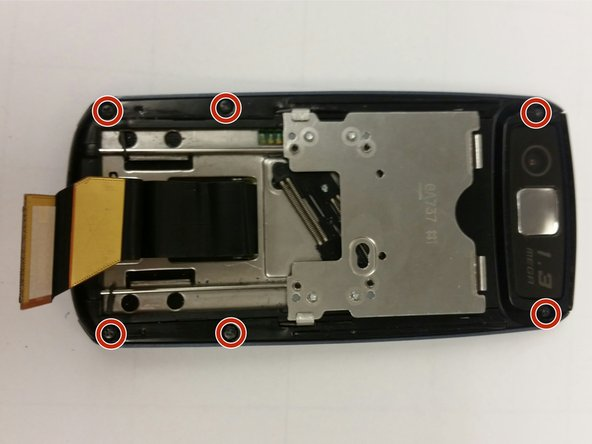 Remove the six visible screws from the outer edge of the device.