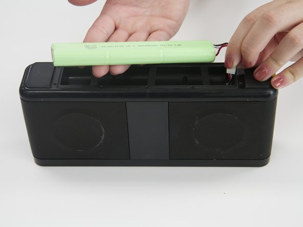Starting from where the wires are connected, gently pull the battery out of the device.