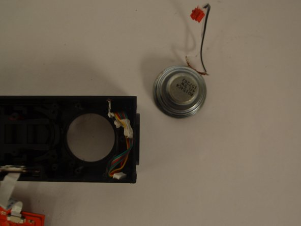 Upon removing the plastic bracket, you will need to remove the adhesive  using either a heating gun or the iOpener kit (both can be purchased under the Parts and Tools Store section of the menu bar) that is holding the speaker in place. Once that is completed, replace the broken speaker with a new, functional speaker.