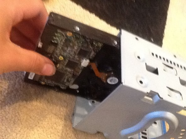 Image 3/3: Then push the hard drive up and then pull it out