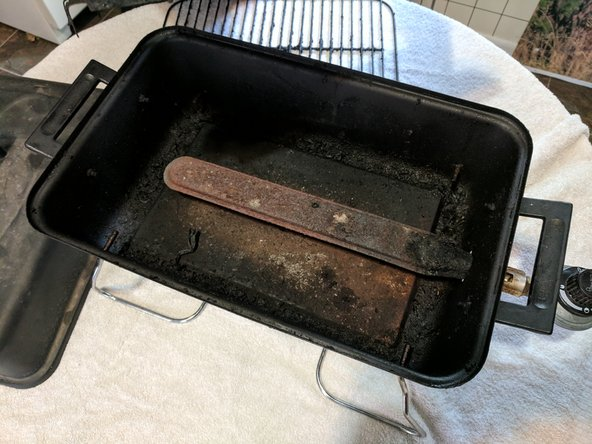 Turn the stove back onto its legs after removing the bottom screw holding it.