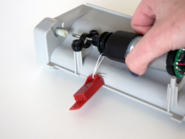 The metal end should line up with a small holder on the brush compartment.