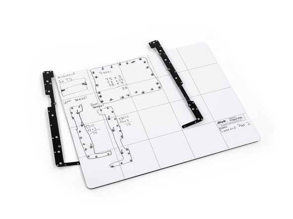 Remove the 25 screws of varying sizes that attach the motherboard to the back plate.
