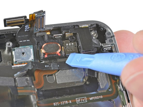 Use the edge of a plastic opening tool to carefully pry the metal front facing camera retainer away from the case of your iPhone.