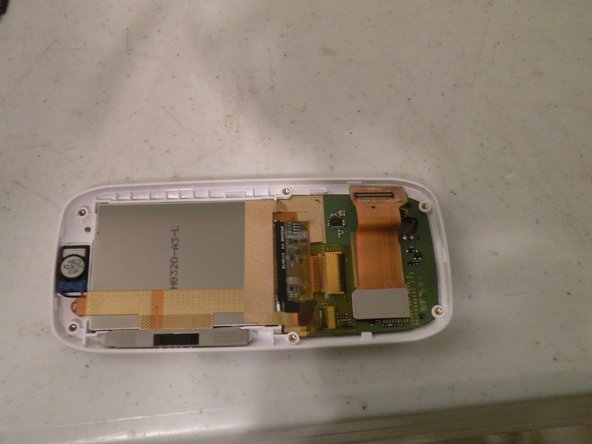 Image 1/2: Now, remove this piece of clear yellow-tinted tape covering the connectors.