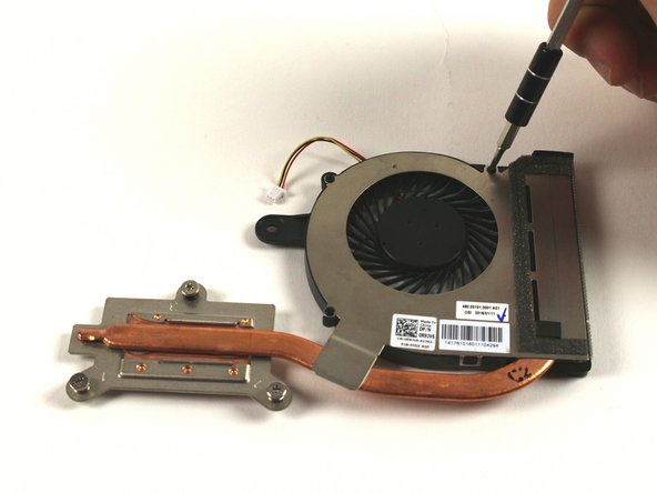 Unfasten the screws shown in the image to remove the cover and heatsink from the fan unit.