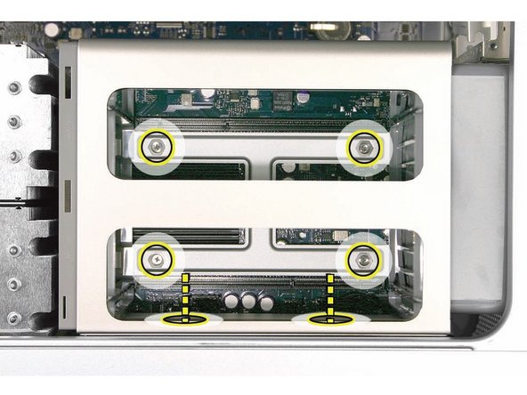 Image 1/1: Rotate the computer so that it is standing vertically. Using a magnetized short-handled or right-angled jeweler's #1 Phillips screwdriver, carefully remove the two short screws that mount the memory cage to the bottom panel of the enclosure.