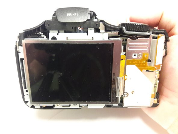 Locate the Internal Button Sensor Plate. This is the white and silver plate to the right of the LCD Display.