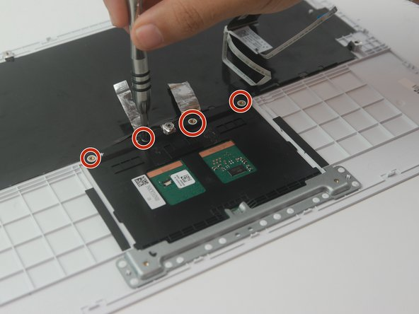 "Using the Phillips #000 screwdriver, remove the (4) four ""4 mm"" screws that secure trackpad onto keyboard."