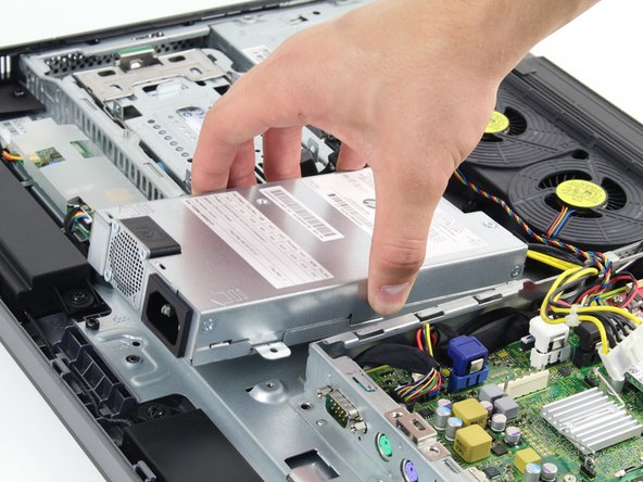 Lift the power supply from the case to remove it.