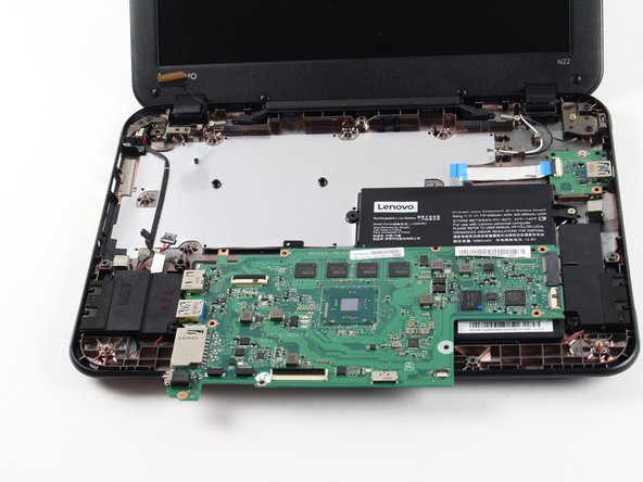 Carefully lift the motherboard up and out of the back panel to remove it.