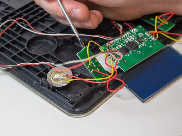 Pry out the PCBs which include the touch sensors (2).