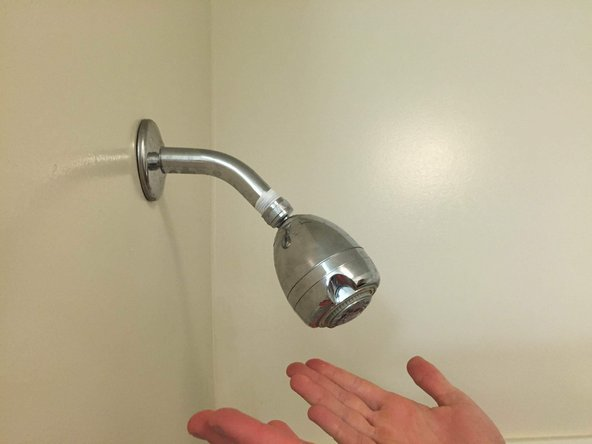 Use your hands to tighten the new shower head back onto the pipe, using a wrench if needed.