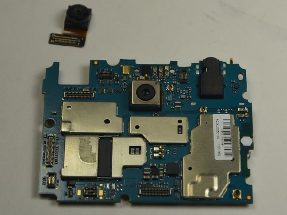 Image 3/3: Use a pair of tweezers to disconnect the front-facing camera by popping the cable off of the motherboard connector.