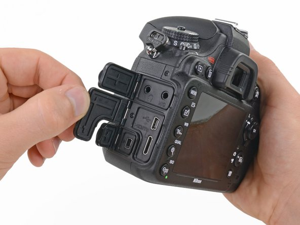 Image 1/3: There are multiple hidden screws throughout the body of the D600.