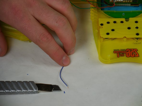 Use a blade or wire stripper to strip 0.5 cm of insulation off the end of the wire(s) to be soldered.