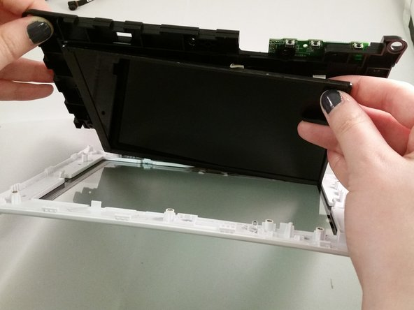 Use hands to detach the screen because it is taped to the back of the motherboard.